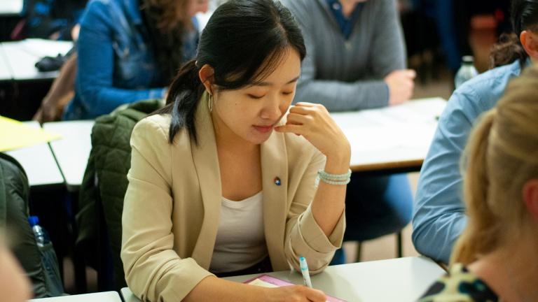 International FREM Student Taking Notes at Workshop