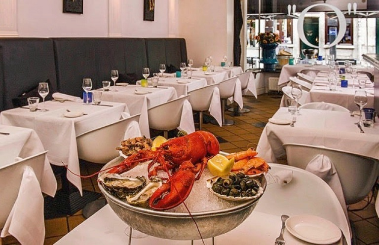 Restaurant, seafood, lobster, ice bucket, table setting with white table cloths, wine glasses on the table