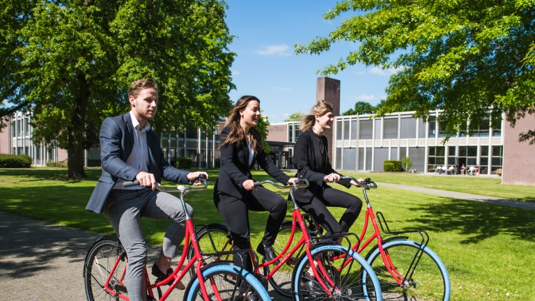 Three Hotel School Maastricht Students cycling on campus